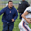 Tribune-Star/Joseph C. Garza<br /> Facing the Braves for a second time: Terre Haute North assistant coach Billy Blundell works with a receiver during team practice Wednesday at North.