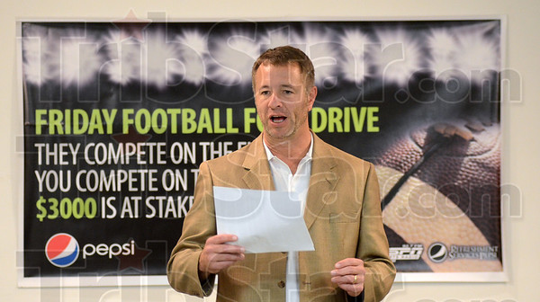 Tribune-Star/Jim Avelis<br /> The winner is: John C. Etling, agency director, Catholic Charities in Terre Haute, announces that West Vigo collected the most food in the Friday Football Food Drive this year.