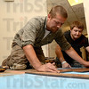 Tribune-Star/Joseph C. Garza<br /> Making it fit: Jeff White and Curtis Rainwater of Chance Bros. Marble & Tile of Indianapolis plan out the configuration of tile in the basement of the Vigo County Public Library Thursday.