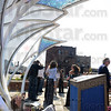 "Tribune-Star/Jim Avelis<br /> Point of view: Betsy Wilkinson of Kiva Structural Engineers gets a unique view of the sculpture ""Renewal"" in front of the Indiana State University Foundation building. Kiva did the construction of the base of the metal and glass artwork at the newly named Meis Plaza."