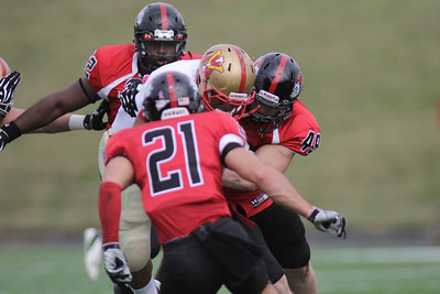 Brian Wittenberger (49) gets the tackle