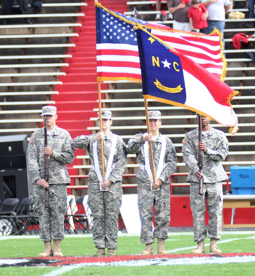 The GWU Color Guard presents the US and NC flag.