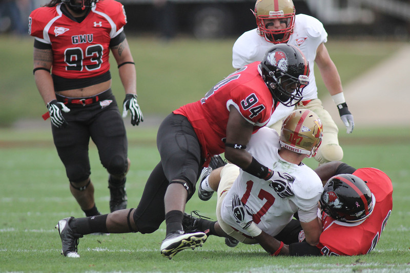 Zach Shelton (94) and Brian Wittenberger (49) take down VMI's player
