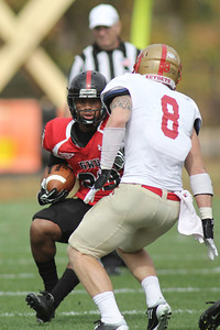 Juanne Blount (23) tries to get past VMI's player