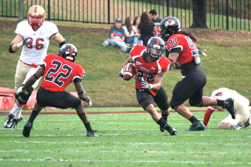 JJ Hubbard (22) runs the ball