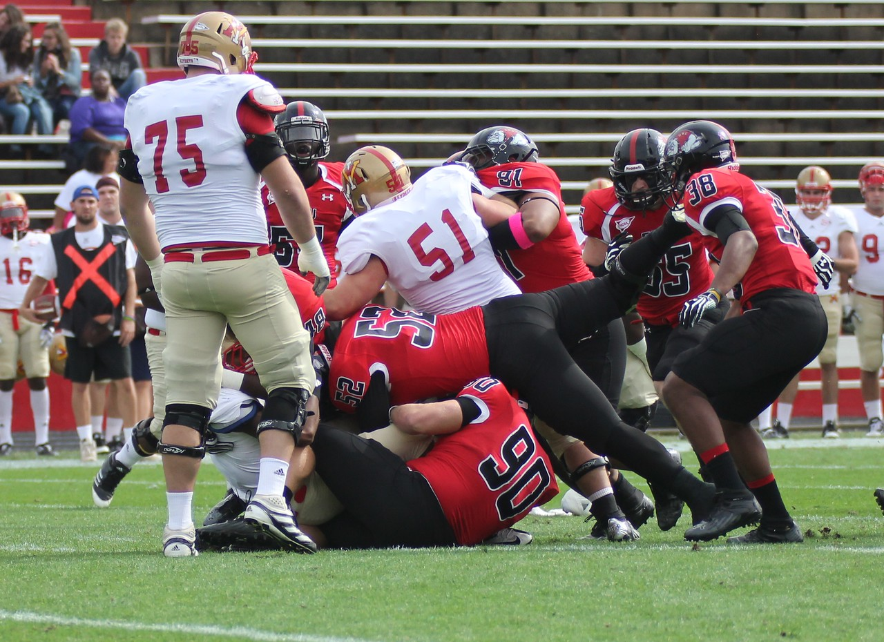 Preston Pemasa (52) tackles  VMI