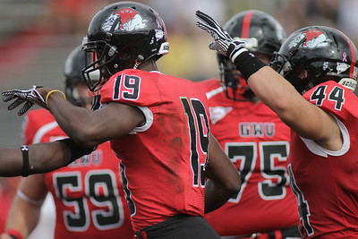 The Runnin' Bulldogs celebrate after Kenny Cook (19) gets a touchdown