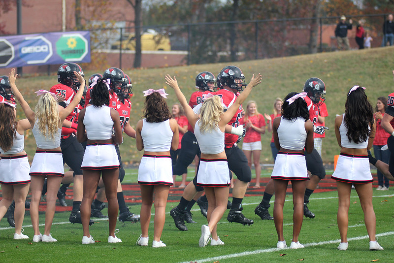 GWU cheerleaders cheer on the Bulldogs as they run onto the field
