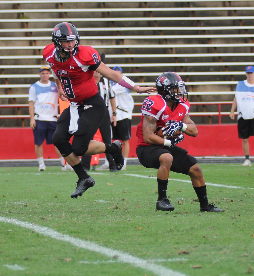 Lucas Beatty (8) hands the ball off the J.J Hubbard (22)
