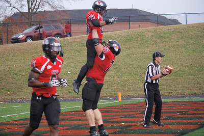 David McConnel (75) rejoices with Demarcus White (84) after a touchdown for the Runnin' Bulldogs