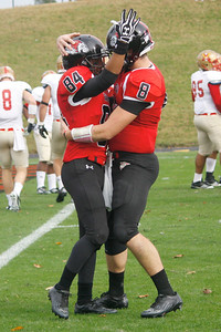 Demarcus White (84) and Lucas Beatty (8) celebrate after a touchdown