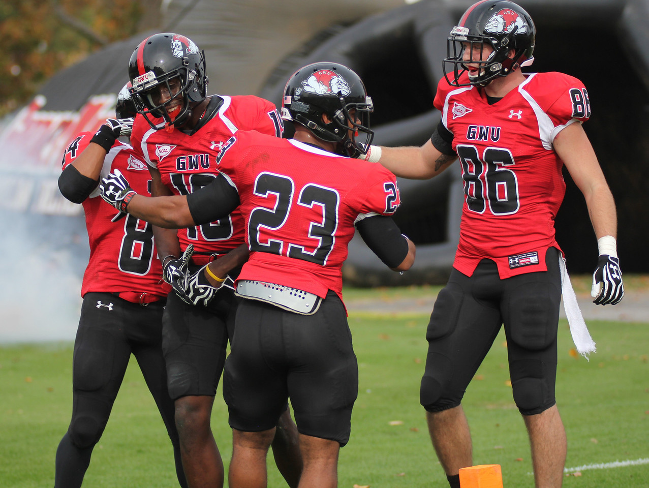 GWU players celebrates Kenny Cook's (19) touchdown
