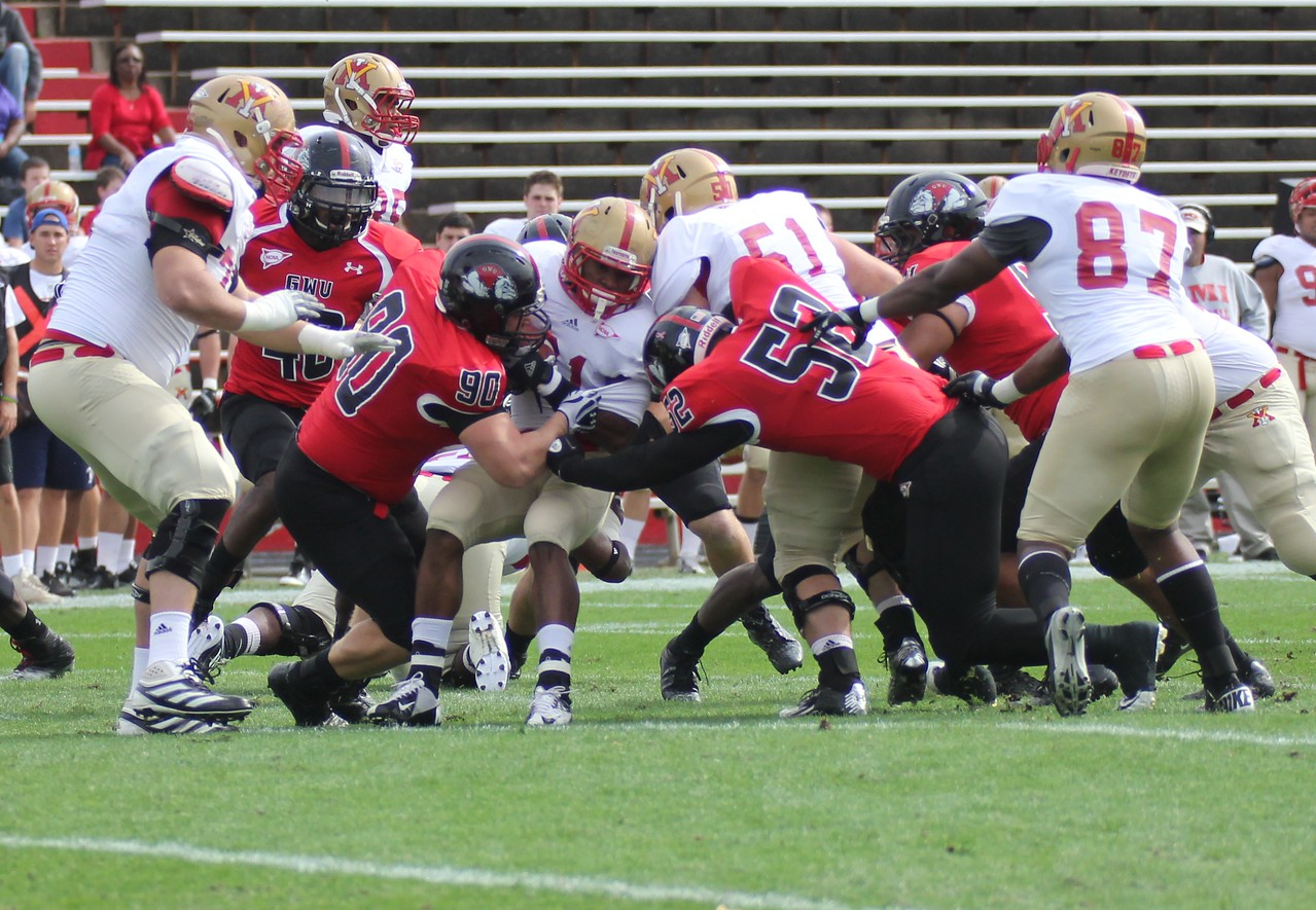 GWU defense tackles VMI