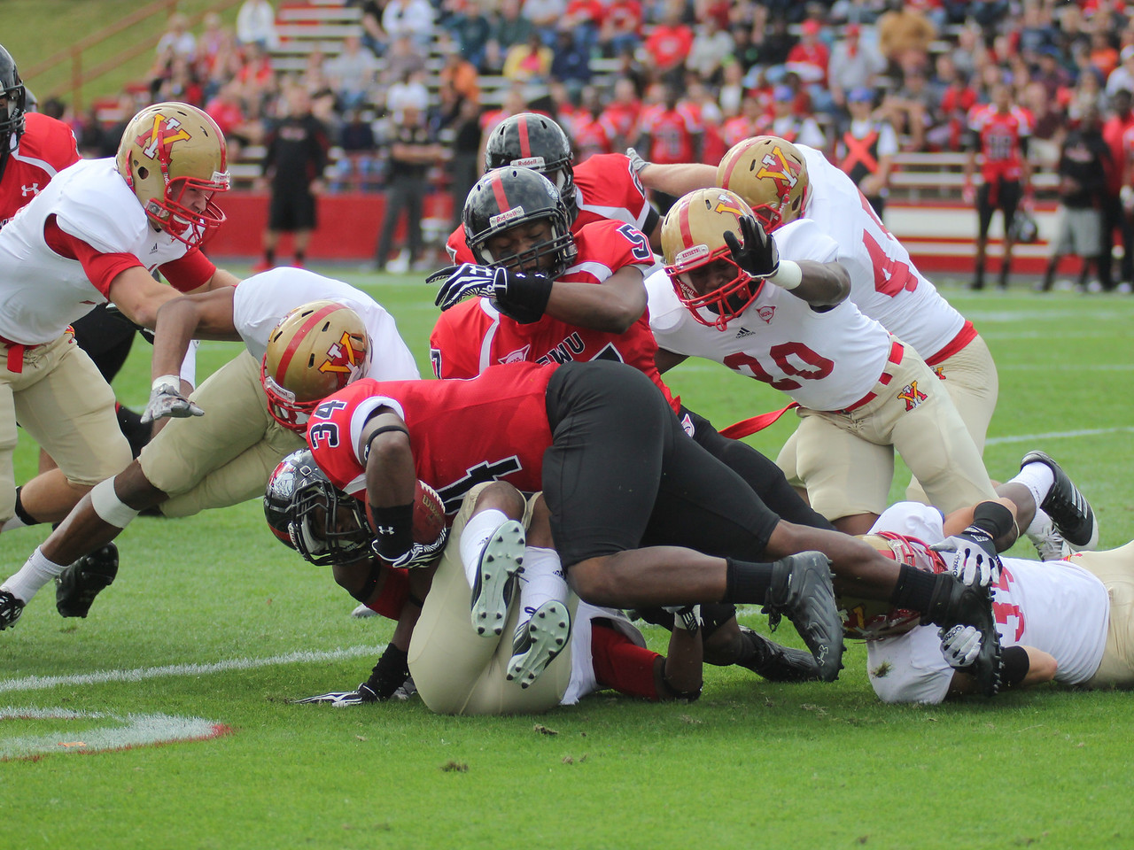 Earnest Harmon (34) carries the ball for GWU