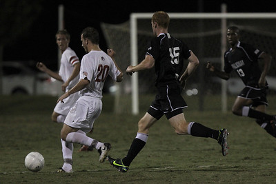 John Sargent (20) keeps the ball away from App