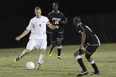 Jon Ole Reinhardsen (4) kicks the ball through App