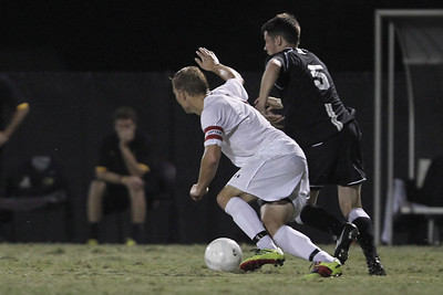 Jon Ole Reinhardsen (4) pushes to get the ball from App