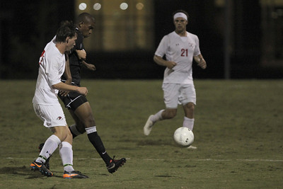 Riley Shelton (27) kicks the ball