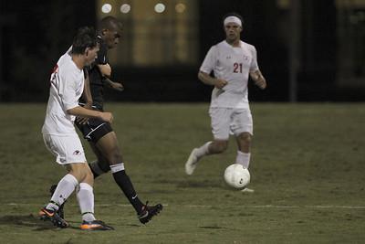 Riley Shelton (27) kicks the ball