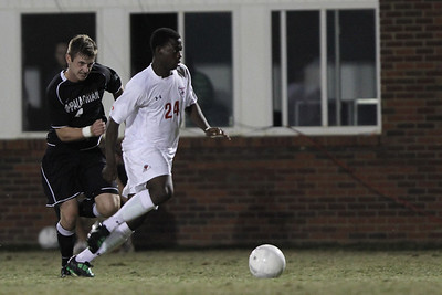 Kevin Comvalius (24) keeps the ball away from App