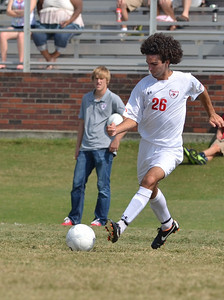 Jonas Nader (26) hustles to dribble the ball down the field.