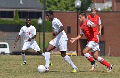 Denzel Clarke (25) works hard to keep the ball from his opponent.