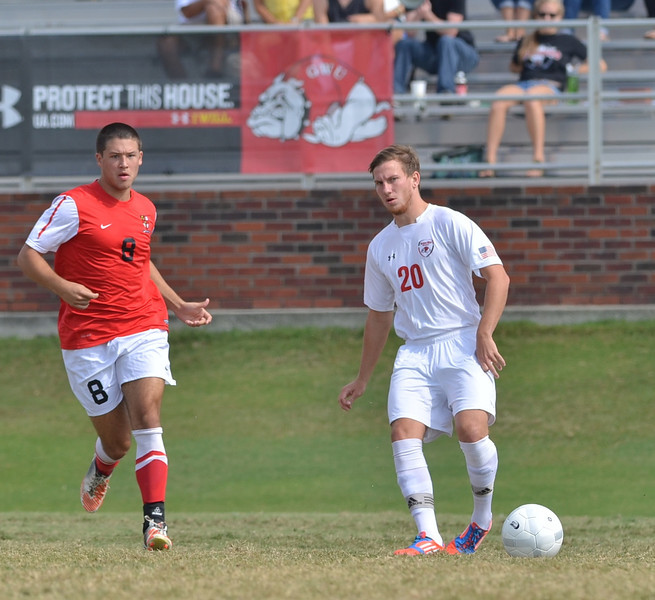 John Sargent (20) passes the ball to his teammate.