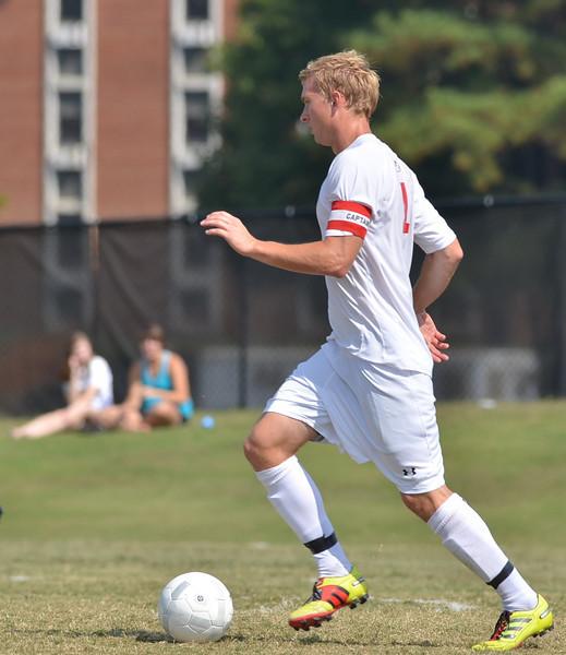 Jon Ole Reinhardsen (4) focus' to move the ball down the field.