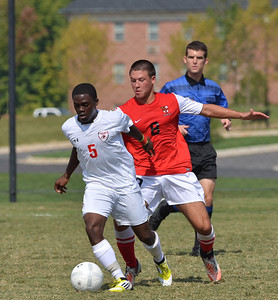 Lyssean Thomas (5) fights hard to keep the ball away from the opposing side.