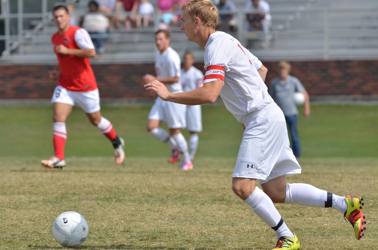 Jon Ole Reinhardsen (4) hustles to move the ball down towards the goal.