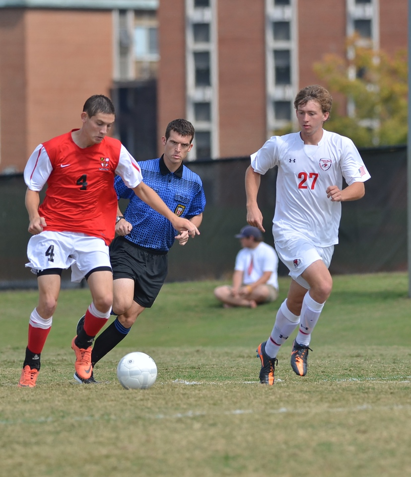 Riley Shelton (27) tries to steal the ball from his opponent.
