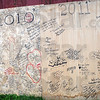 Messages: Detail photo of boards signed by participants in the last two Olympic Games on the Parke County farm.