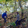 Hunt: Indiana State University students Mallory Metheny and Kasey Kahle walk near the banks of the Wabash River in search of removeable debris Sunday afternoon.