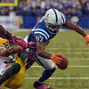 Broke the plane: Indianapolis wide receiver Reggie Wayne holds the ball over the goal line to score a touchdown as he is pulled back by a Green Bay defender during the Colts' win Sunday in Indianapolis.