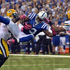 Mid-air connection: Indianapolis tight end Dwayne Allen,center, hangs onto the ball as he makes a catch between two Green Bay defenders Sunday during the Colts' win over the Packers.