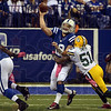 Tough part of the job: Indianapolis quarterback Andrew Luck is hit by Green Bay's D.J. Smith as Luck passes the ball during the Colts' win Sunday in Indianapolis.