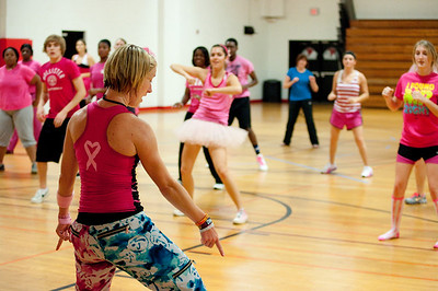 Students dance along with the instructor during Party for the Cure Sunday night in Bost Gym.