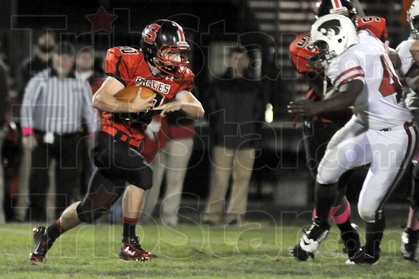 Run: South's #20 Ian Newton carries the ball during first half action against Lawrence North High School Friday evening.