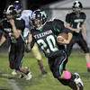 Yardage: West Vigo's #20 Jacob Creasey looks for running room during first half action against Sullivan Friday evening.