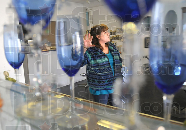 Shake: Amber Smith, owner of Amber Glass talks about the rattling glass when the survey crew shook the ground in front of her Poplar Street business Friday afternoon.