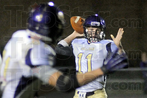Lookin': Sullivan quarterback #11 Payne Fortner looks to a receiver during first half action at West Vigo Friday night.