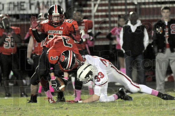 Loose: South's #3 Tyler Seibert and Lawrence North's #33 Matt Shaw battle for the ball just before half time Friday night.