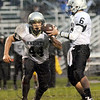 Eye on the ball: Northview's #44, Jesse Miller eyes the ball on a hand-off from quarterback #6 Tucker Stewart.