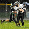 Slippery when wet: Northview's 30 Ben Girton evades the tackle of West Vigo defender #11 Chris Neidlinger during first half action at the westside school.