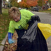 Tribune-Star/Joseph C. Garza<br /> Kim Kimbler of the Terre Haute Women's Club finds a discarded lid and straw to dispose of as she and her fellow Keep Terre Haute Beautiful volunteers cleaned up along Sixth Avenue Saturday.