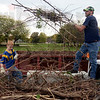 Tribune-Star/Joseph C. Garza<br /> Dalton Higgins and his dad, David, dispose of sticks, limbs and brush as part of the Keep Terre Haute Beautiful campaign Saturday at Spencer Ball Park.