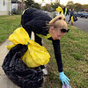 Tribune-Star/Joseph C. Garza<br /> Terre Haute South teacher Amy Jarvis picks up a can as part of the Keep Terre Haute Beautiful campaign coordinated by Trees, Inc., and the city. Jarvis, along with students Taylor Schilling and Sarah Sim, were representing the South Eco Citizens Club.