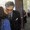 Kiss: Volunteer worker Mallory Cammack kisses Elliott Gould after a brief conversation and having her photo taken with him just prior to the start of the 7th Annual CANDLES. Fall Reception.