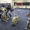 Workout room: Rev. Tim Fagg rides a stationary bike in the workout room of the Conner's Center Friday afternoon.