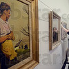 Tribune-Star/Joseph C. Garza<br /> America in art: Collections manager Jennifer Lanman makes her way around one of the galleries in the Swope Art Museum to hang various paintings for the John Rogers Cox exhibit Tuesday.
